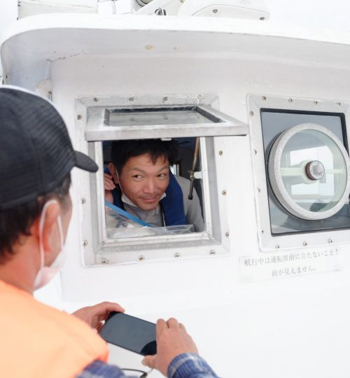 Tour guide on boat